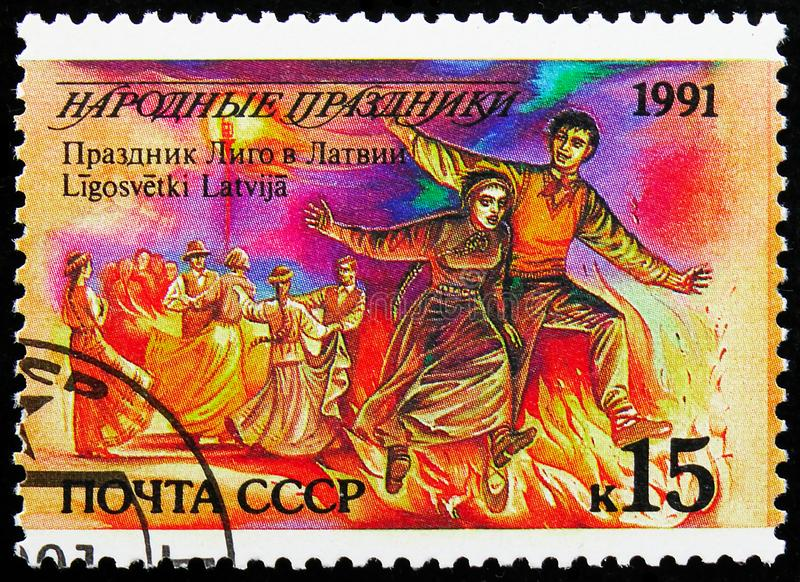 Ligo Holiday, Latvia, Folk Festivals serie, circa 1991. MOSCOW, RUSSIA - AUGUST 31, 2019: Postage stamp printed in Soviet Union Russia shows Ligo Holiday, Latvia stock images