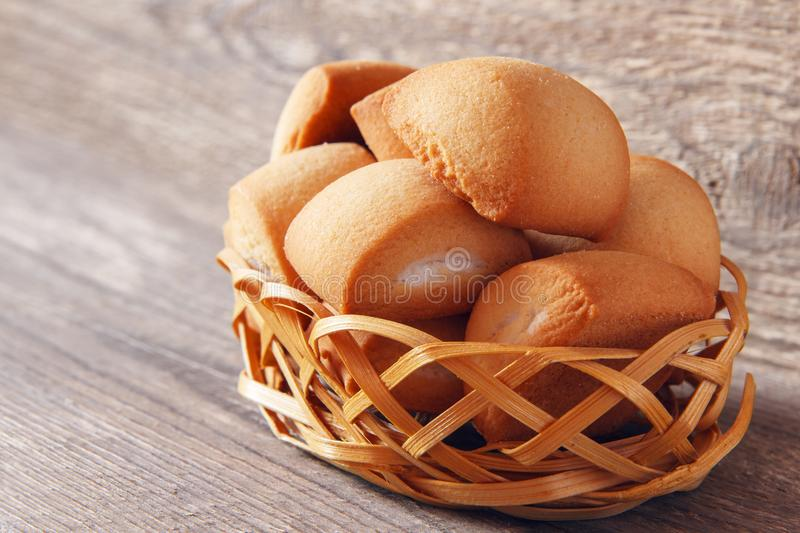 Ligth homemade breakfast from fresh cookies in wicker basket on wooden background. Rustic concept stock photos