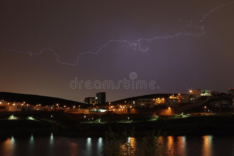Ligthing over the Dam. An Horizontal ligth over El Rejon Dam and a residential place