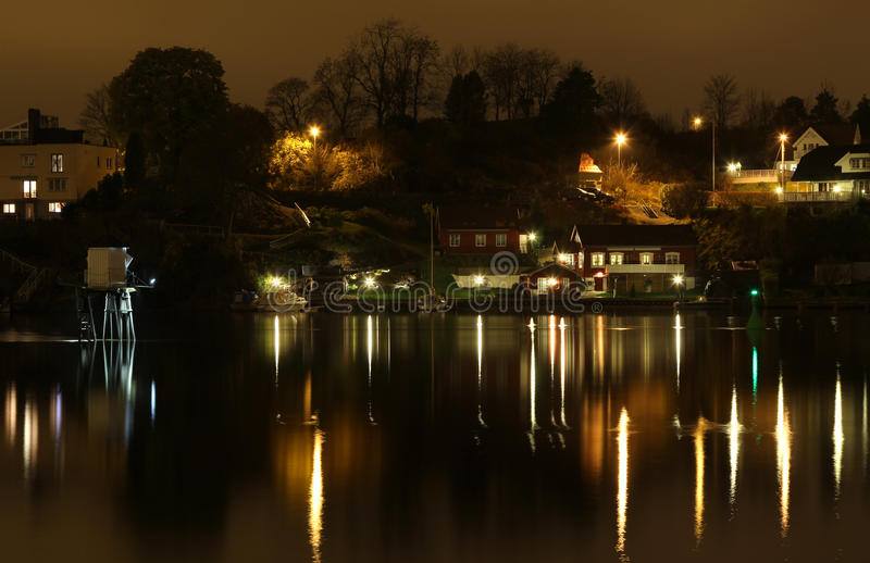 Ligthouse in the night. Small ligthouse in the river. Porsgrunn, south Norway stock photos