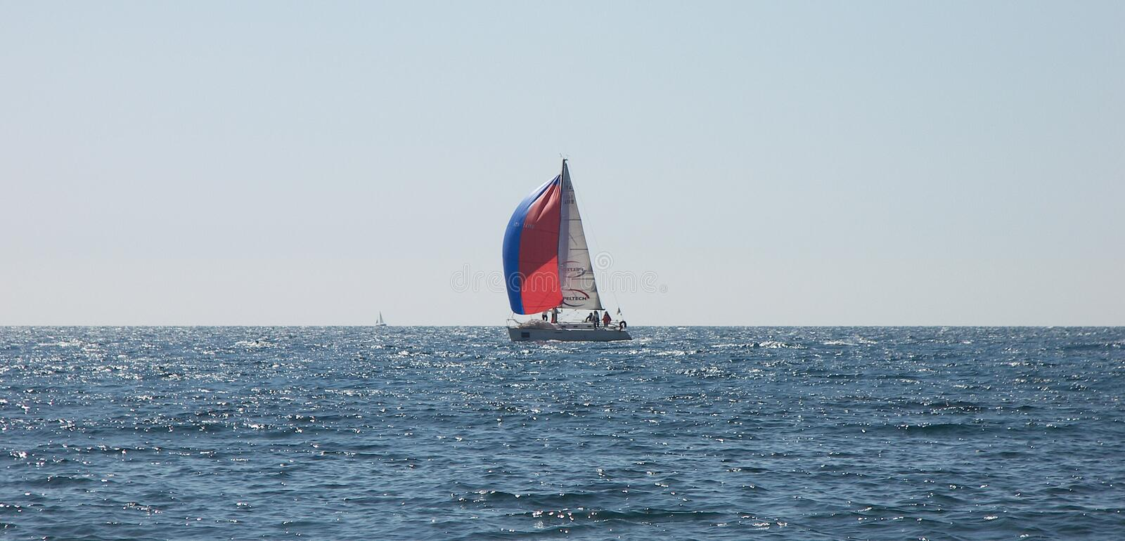 Sailing race wind. LIGURIA, ITALY, April 2011: touristic trip. Transport device, especially sailing race boat, featuring wind royalty free stock photo