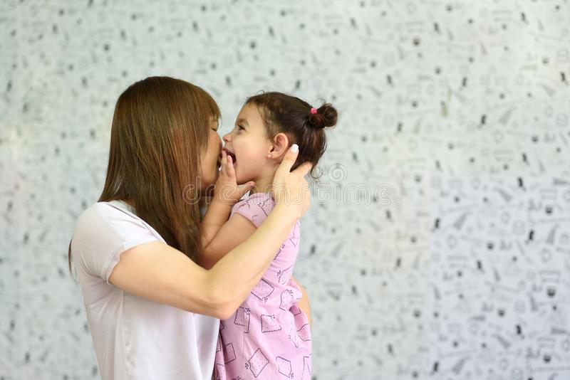 Liitle child spend time with young grandma. royalty free stock image