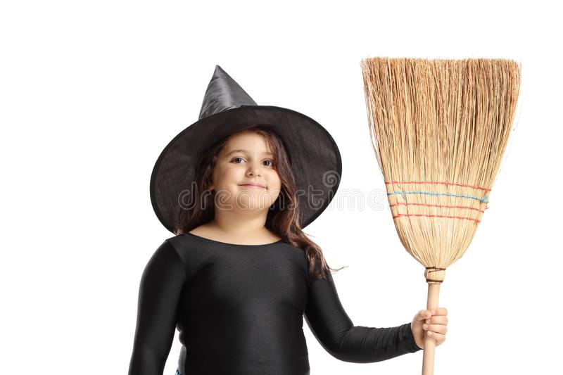 Liittle girl dressed as a witch with a broom for Halloween. Isolated on white background stock photo