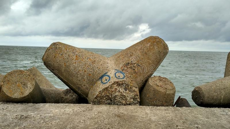 Lijepaya moll art. Baltic sea breakwater royalty free stock images