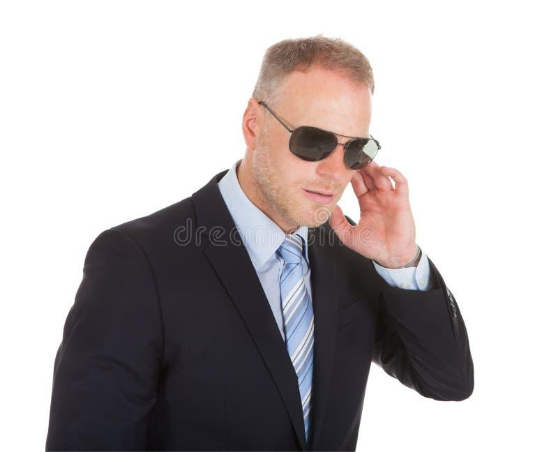 Lijfwacht die zonnebril dragen stock fotografie
