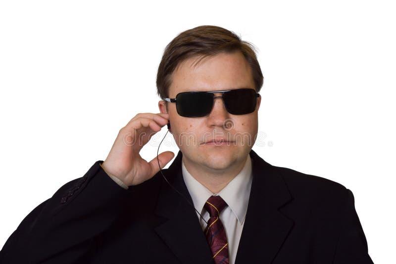 Lijfwacht in zonnebril stock foto's