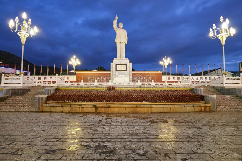 Mao Tse Tung statue in the Red Sun Square at night. royalty free stock photography