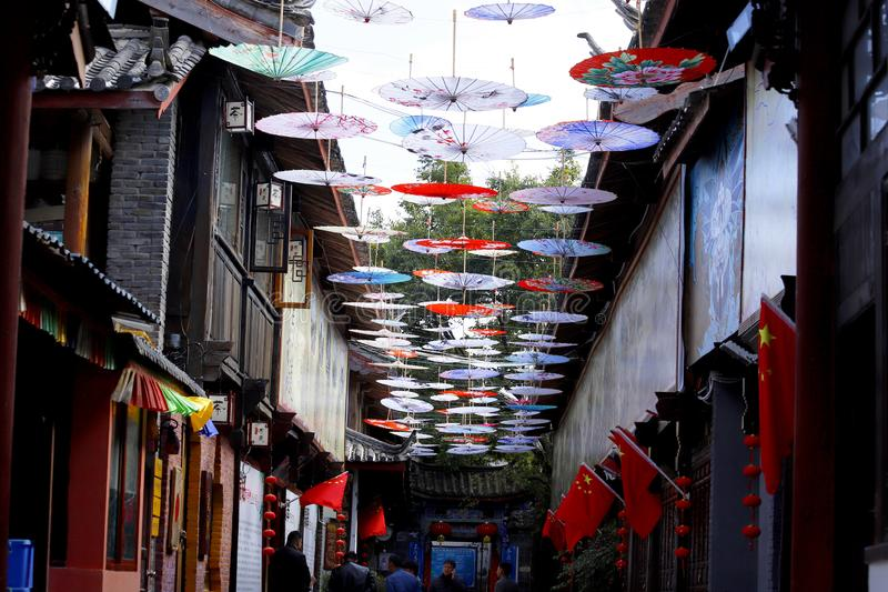 Umbrella-shaped decorations in a street in the village of Shu-He near Lijiang, Yunnan, China stock images