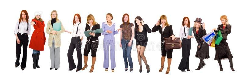 Lijn van vele geklede meisjeszaken en toevallig stock foto