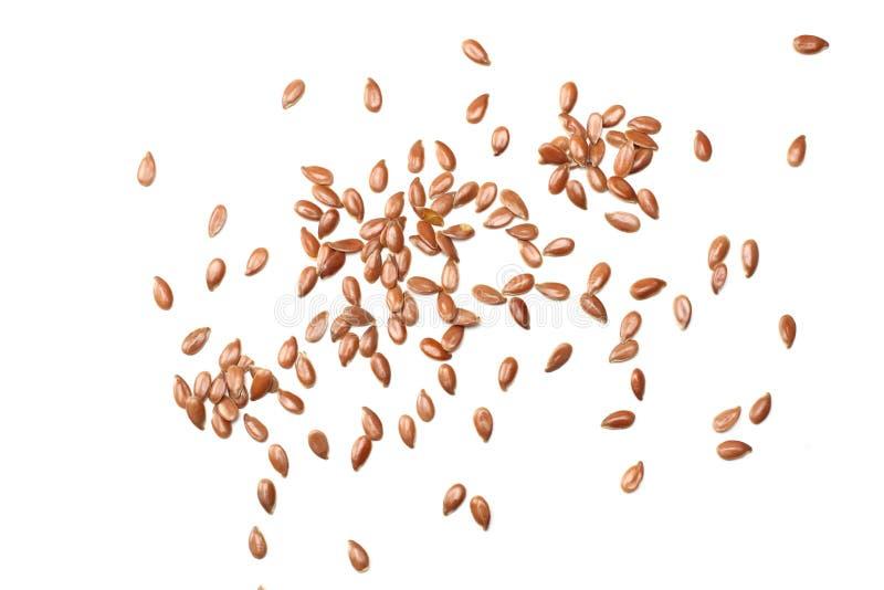 Lijnzaad dat op Witte Achtergrond wordt geïsoleerdb lijnzaad of lijnzaad graangewassen Gezond voedsel Hoogste mening stock fotografie