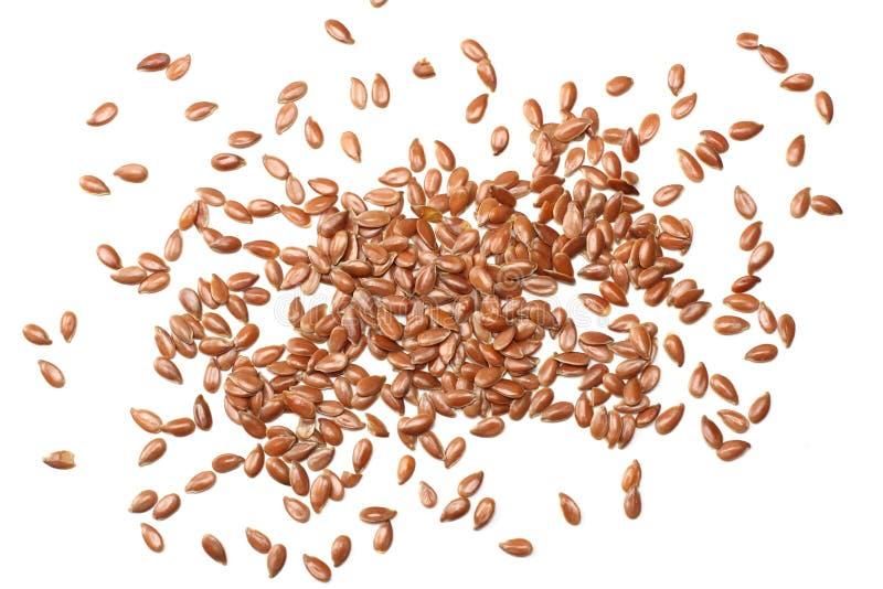 Lijnzaad dat op Witte Achtergrond wordt geïsoleerdb lijnzaad of lijnzaad graangewassen Gezond voedsel Hoogste mening stock foto's