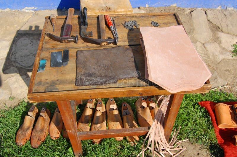Lijst van schoenmaker stock fotografie
