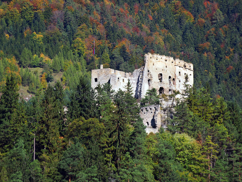 Likava Castle ruin hidden in forest. View of Likava Castle ruin surrounded by deep forests in autumn. This castle ruin is wide known because it is believed that stock image