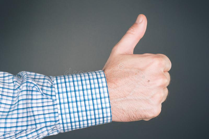 Like and approve hand gesture with thumb up. Businessman accepting terms with gesticulation stock images