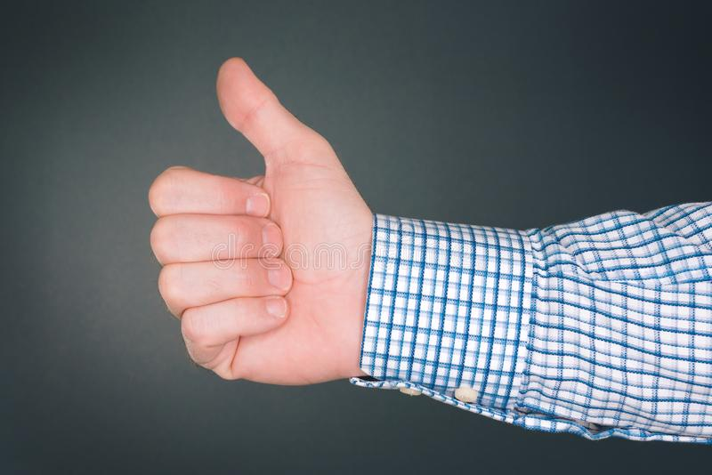 Like and approve hand gesture with thumb up. Businessman accepting terms with gesticulation stock image