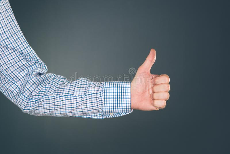 Like and approve hand gesture with thumb up. Businessman accepting terms with gesticulation royalty free stock photos