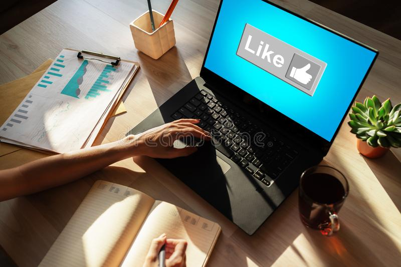 Like button on screen. SMM, Social media marketing concept. royalty free stock photography