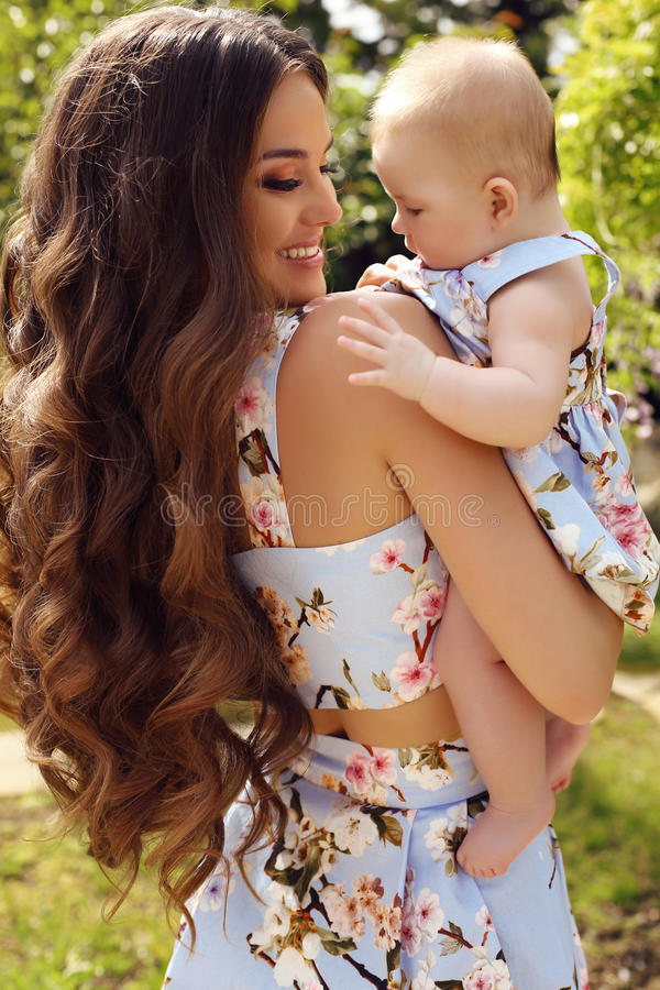 Like mother like daughter. beautiful family in similar dresses stock photography