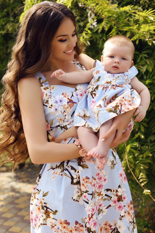 Like mother like daughter. beautiful family in similar dresses stock photo