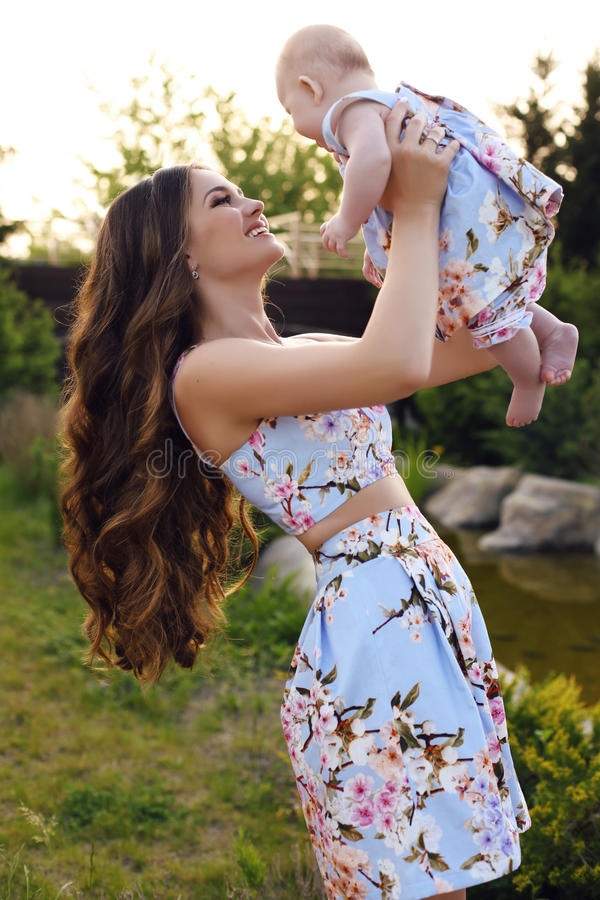 Like mother like daughter. beautiful family in similar dresses stock photos
