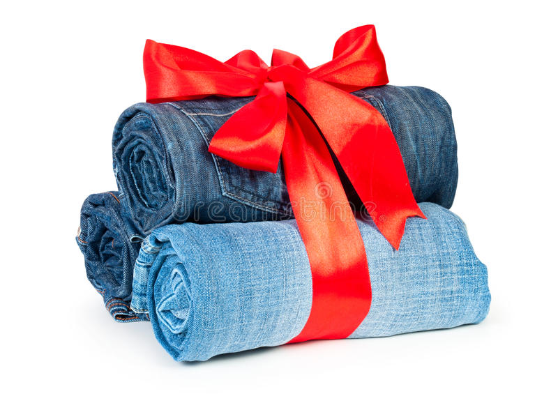 Like a roll blue denim jeans arranged in stack gif stock images