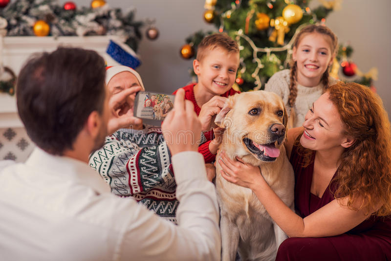 We like spending holidays with our puppy royalty free stock image
