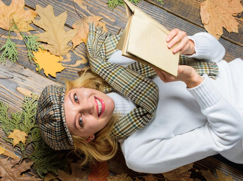 She likes detective genre. Woman lady in checkered hat and scarf read book. Girl in vintage outfit enjoy literature stock images
