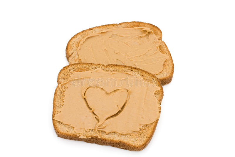 Liking peanut butter toast. Two pieces of whole wheat toast isolated on a white background, Liking peanut butter toast royalty free stock photography