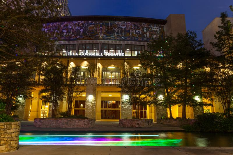 SAN ANTONI, TEXAS - NOVEMBER 10, 2017: Lila Cockrell Theatre situated on the River Walk with boat light trail passing thru stock photography