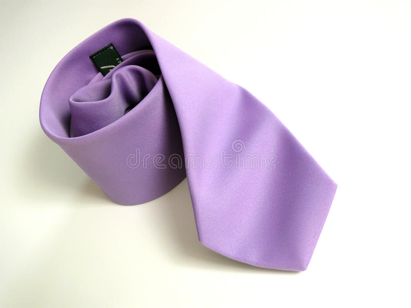 Lila tie. On gray background stock images