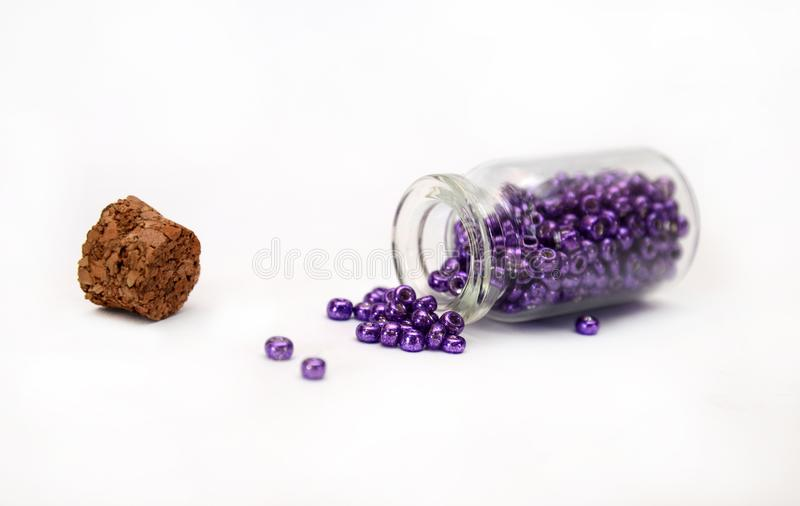 Lilac Beads in bottle with cork royalty free stock images