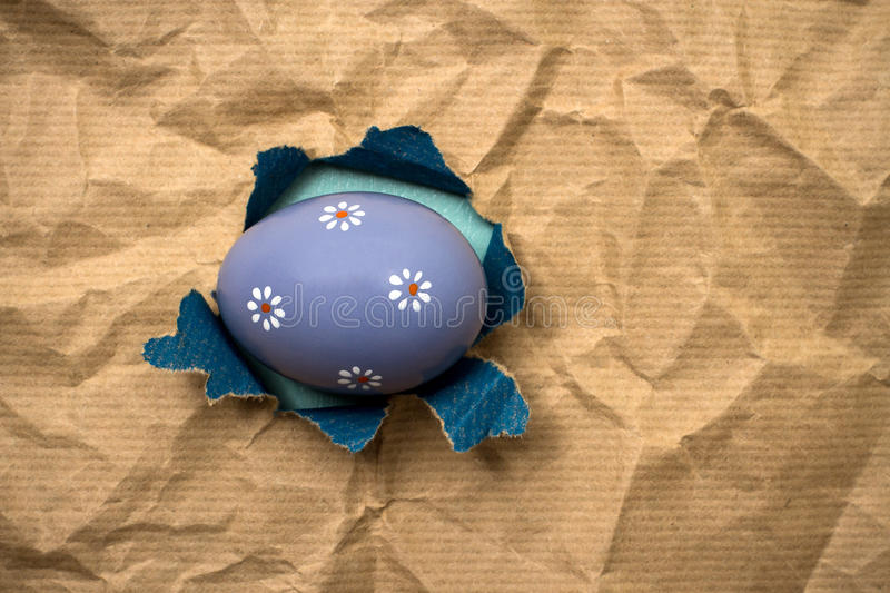 Download Lilac Eastern Egg In Hole  Brown Wrapping Paper Stock Photo - Image: 83706177