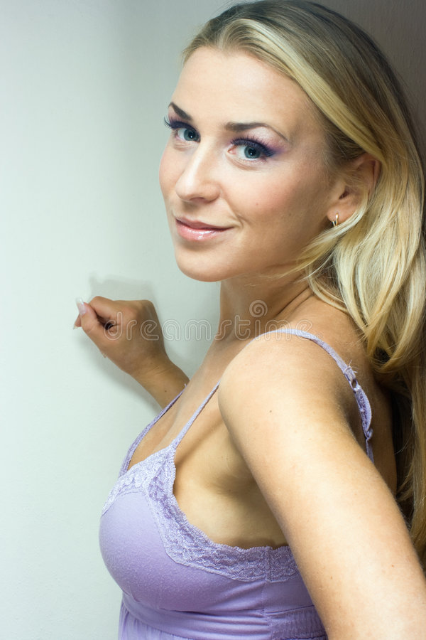 Lilac fantasy. Blond girl in lilac in studio shot royalty free stock photos