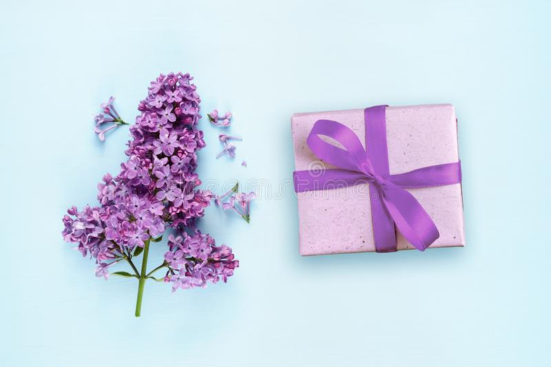 Lilac flowers and gift box stock images
