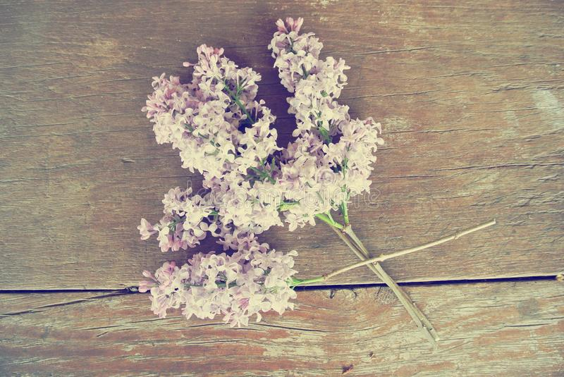 Download Lilac Flowers On The Rustic Wooden Table Vintage Concept Stock Photo