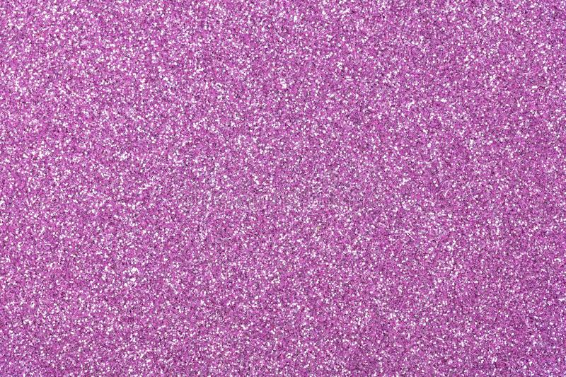 Lilac glitter background for your new desktop, texture as part of your Christmas design. High resolution photo stock image