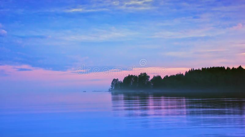Lilac Seascape With Pink And Blue Clouds After Sunset stock photography