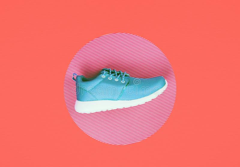 Lilac sneakers on Living Coral background. royalty free stock photos