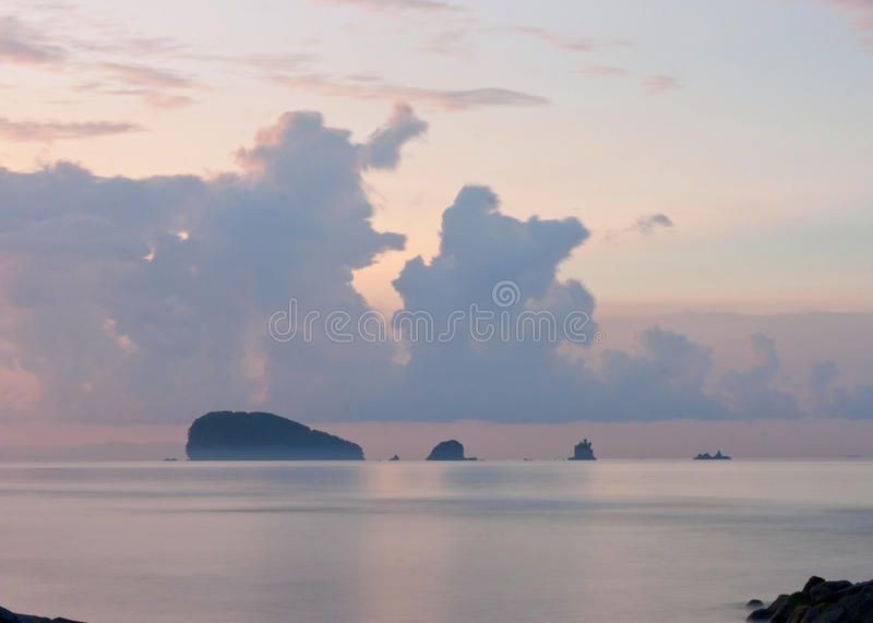 Lilac sunrise on the ocean. Beautiful pink purple sea view with islands. It can be used to illustrate about travel, nature, ocean, yoga, philosophy and poetry royalty free stock photography