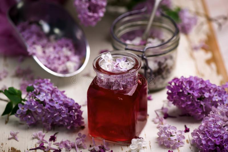 LILAC syrup in glass jar.Style vintage royalty free stock photos