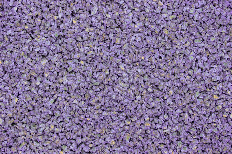 Lilac violet rubber coating for children playground. Texture granular background. Outdoor floor covering for sports fitness games royalty free stock photos