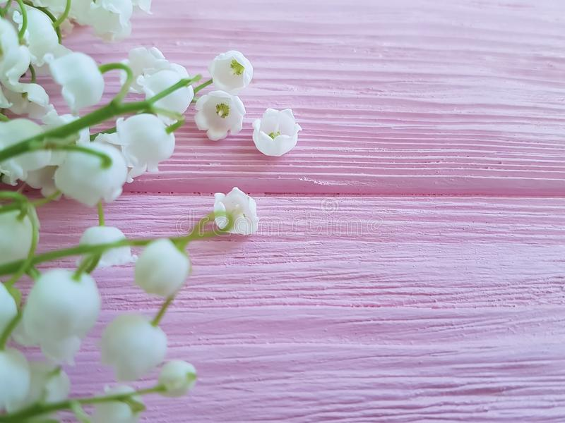Lilies of the valley bouquet on pink wooden may arrangement romance spring flowers fragrant royalty free stock photography