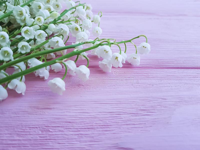 Lilies of the valley on pink wooden spring flowers fragrant royalty free stock photo