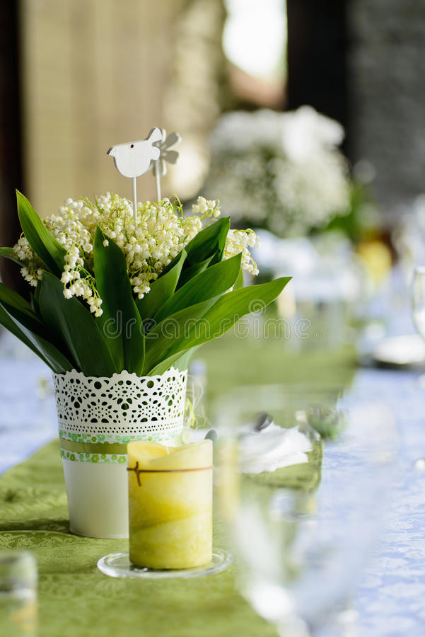 Lilies of the valley on the wedding table royalty free stock images