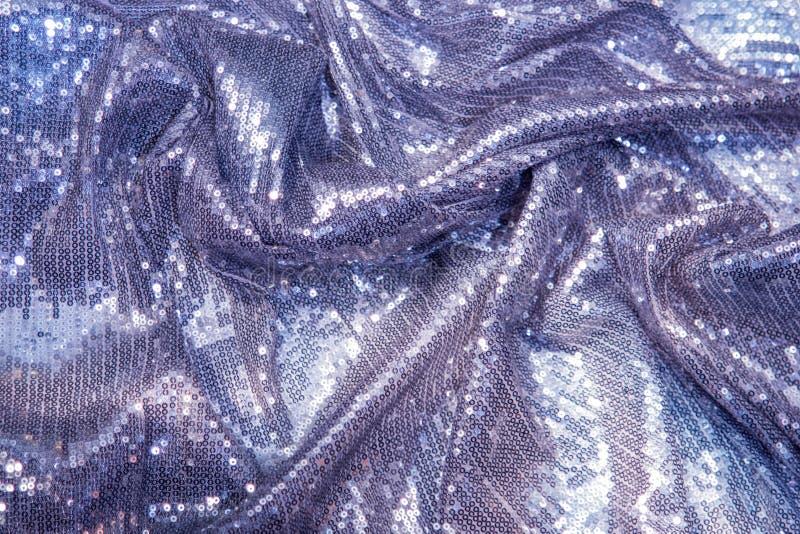 Lillà, porpora, viola, zecchini blu - tessuto a paillettes scintillante fotografie stock libere da diritti