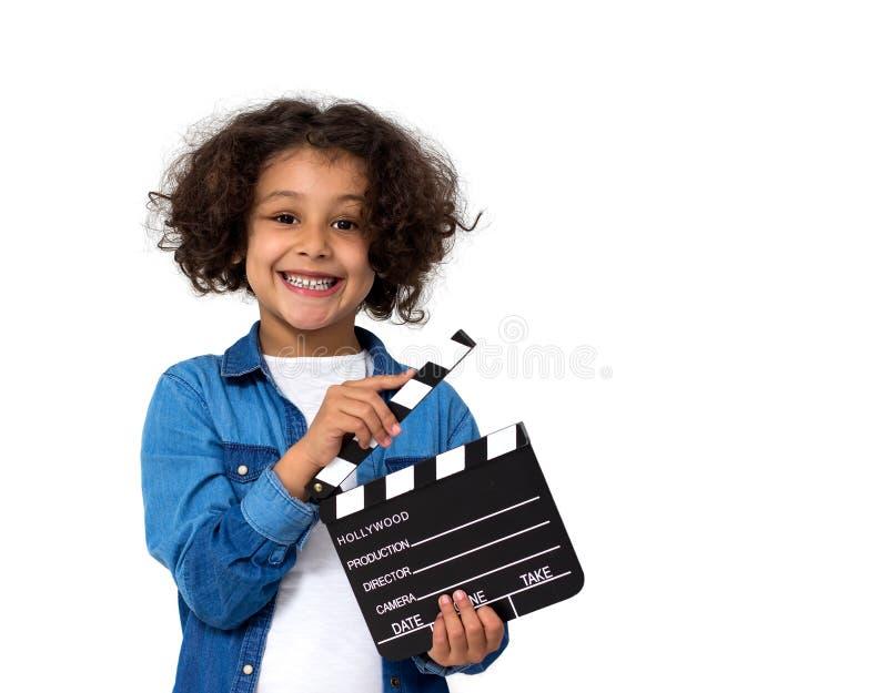 Lilla flickan med film kritiserar royaltyfri foto