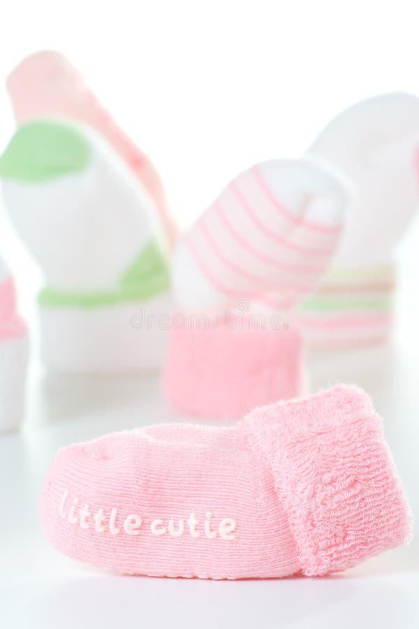 lilla sockor för cutie arkivfoto