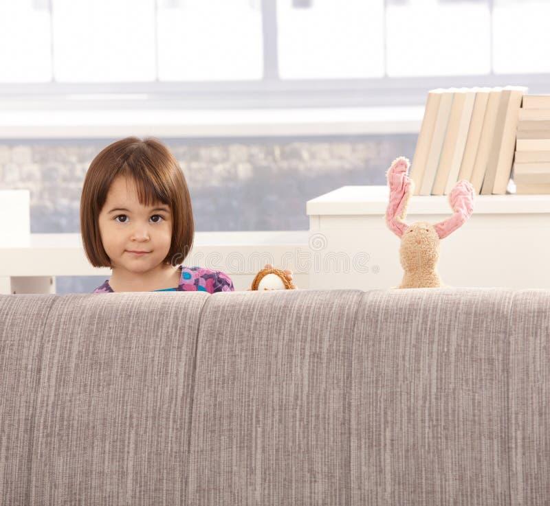lilla toys för gullig flicka royaltyfria bilder