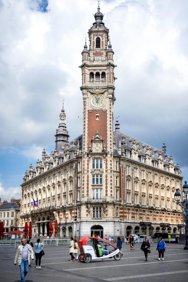 LILLE: Chamber of commerce in Lille in a summer day under the cloud sky stock image