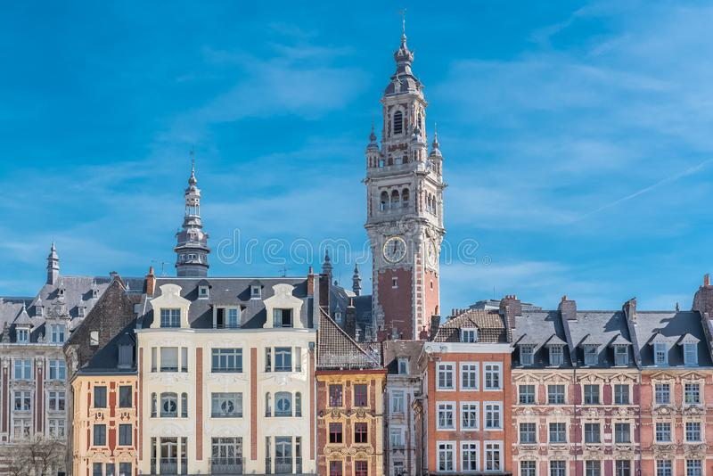 Lille, former facades in the center. Lille, old facades in the center, the belfry of the Chambre de Commerce in background royalty free stock images